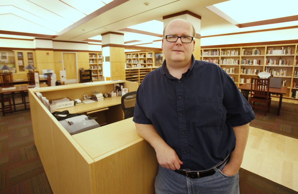 Photo - Larry Johnson is in charge of Oklahoma images, Oklahoma books and the Oklahoma Room for the Metropolitan Library System.  PAUL HELLSTERN