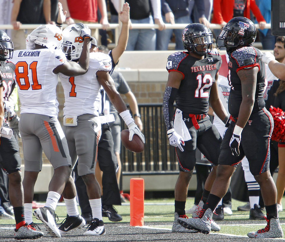 Oklahoma State Cowboys wide receiver Justin Blackmon (81) and Joseph Randle (1) celebrate a touchdown during the college football game between the Oklahoma State University Cowboys (OSU) and Texas Tech University Red Raiders (TTU) at Jones AT&T Stadium on Saturday, Nov. 12, 2011. in Lubbock, Texas.  Photo by Chris Landsberger, The Oklahoman  ORG XMIT: KOD