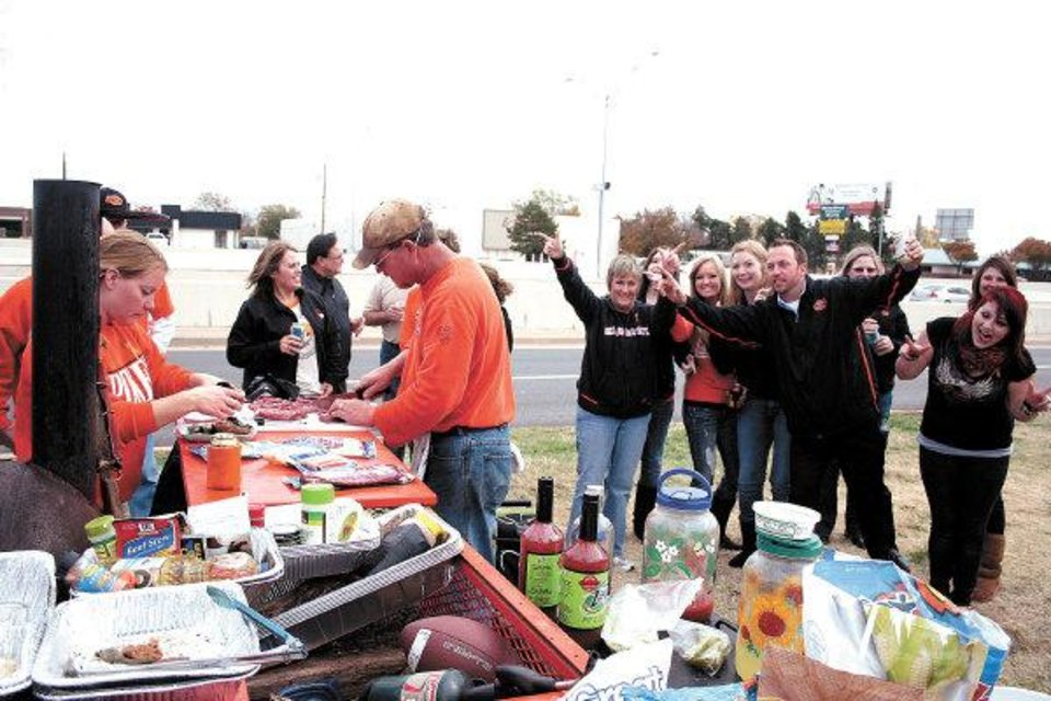 Oklahoma State fans from rally around the Kingfisher tailgate, which was the 2010 Bedlam Tailgating Showdown winner. THE OKLAHOMAN - DAVE CATHEY