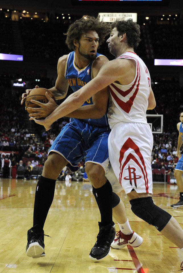 New Orleans Hornets' Robin Lopez, left, faces Houston Rockets' Omer Asik, right, during the first half of an NBA basketball game, Wednesday, Nov. 14, 2012, in Houston. (AP Photo/Pat Sullivan)