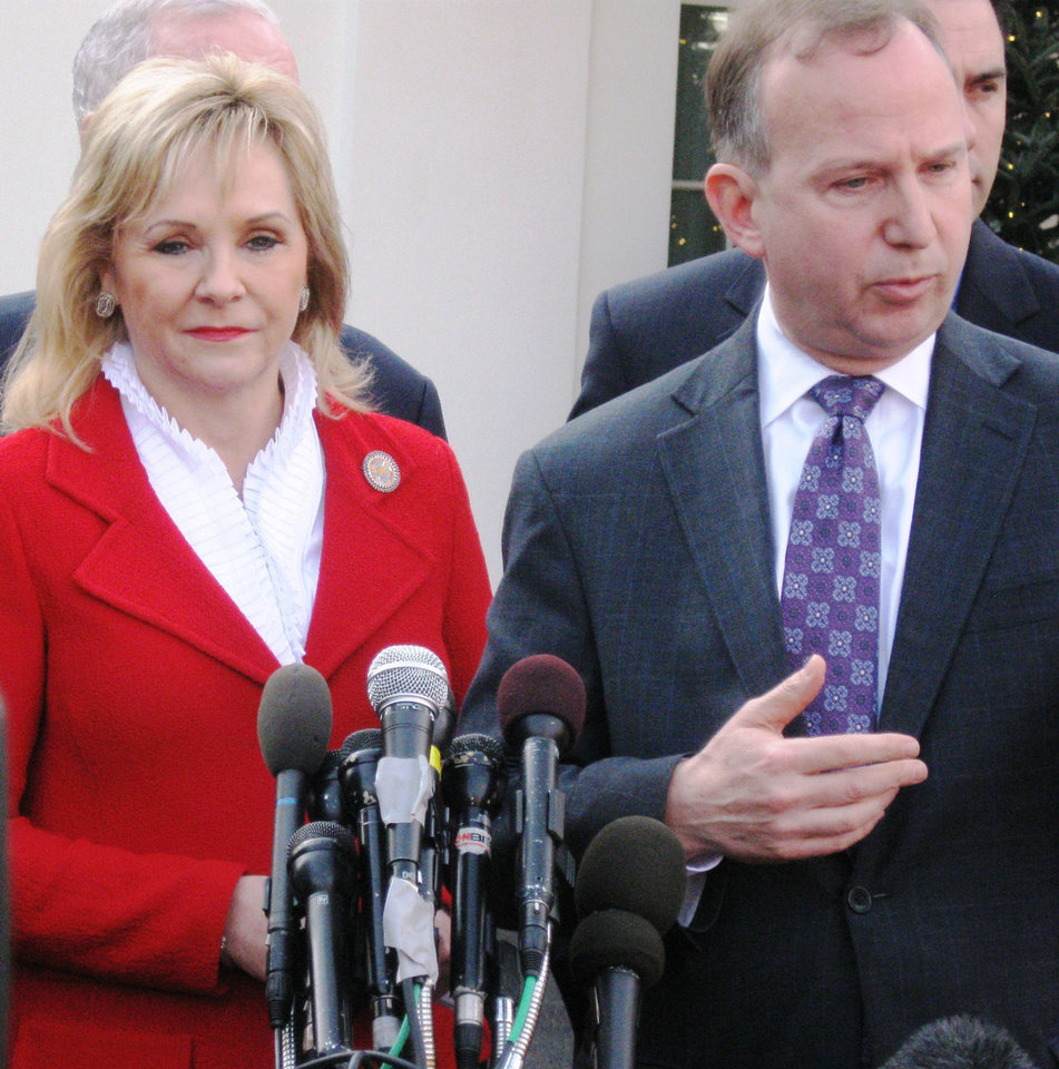 Gov. Mary Fallin and Delaware Gov. Jack Markell talk to reporters outside the White House on Tuesday after meeting with President Barack Obama about fiscal issues. <strong>Chris Casteel - The Oklahoman</strong>