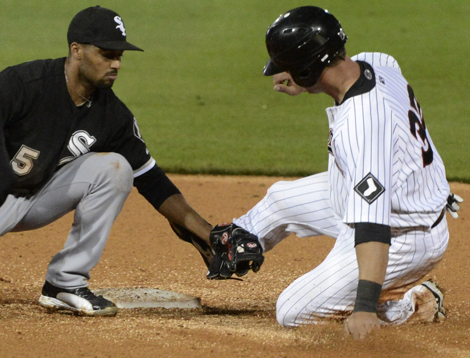 Photo - Chicago White Sox's Marcus Semien, left, tags out Birmingham Barons' Kevan Smith during a spring exhibition baseball game in Birmingham, Ala., Friday, March 28, 2014. (AP Photo/ AL.com, Mark Almond) MAGAZINES OUT