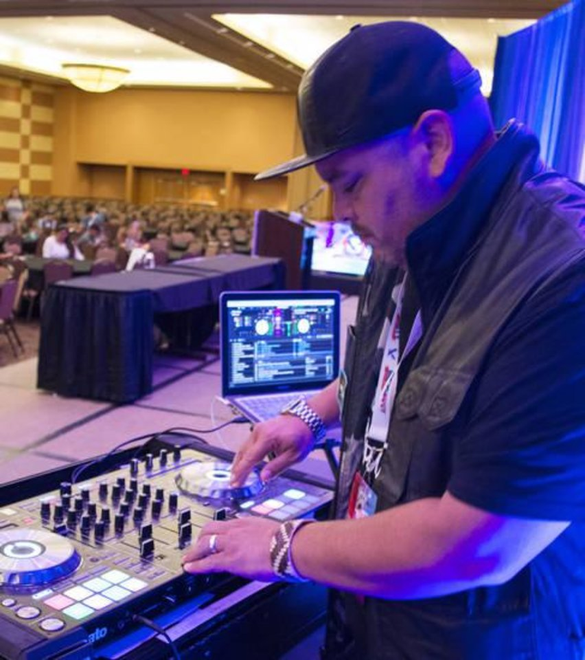 Photo -  Marcus Guinn, a disc jockey with N7, performs for the UNITY conference. [PHOTO BY ERIECH TAPIA, THE OKLAHOMAN]