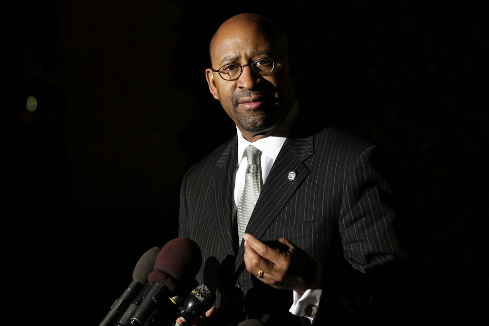 Photo -   Philadelphia Mayor Michael Nutter speaks to the media outside of the White House, after Vice President Biden met with mayors from cities across the country to talk about taxes and the economy, in Washington, Thursday, Nov. 15, 2012. (AP Photo/Jacquelyn Martin)