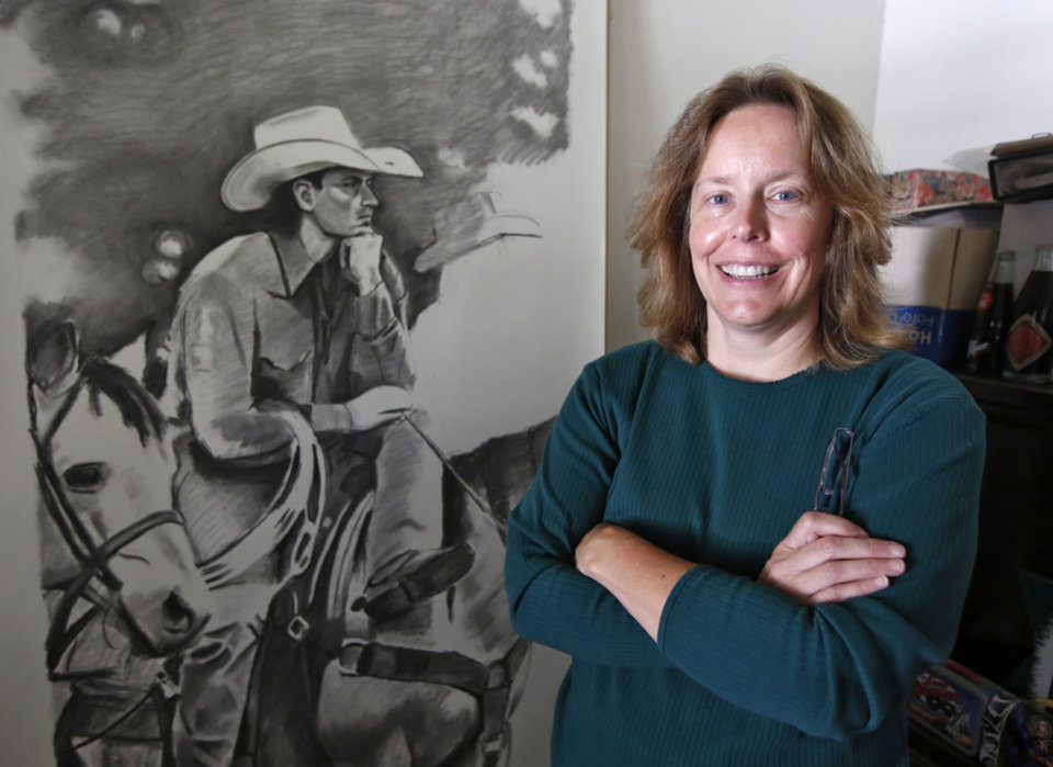 Photo -  Renee Lawrence, pictured with one of her drawings, is among the artists scheduled to show work at the Arts Festival Oklahoma Saturday through Monday at Oklahoma City Community College, 7777 SS May Ave.  Photo By Steve Gooch, The Oklahoman  Steve Gooch -  The Oklahoman