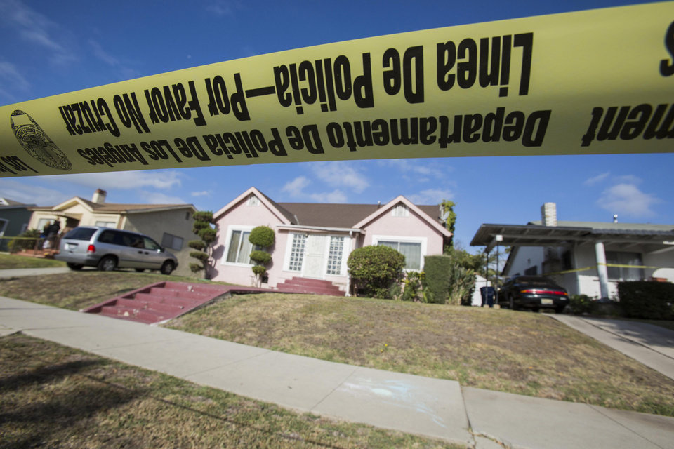 Photo - Yellow police tape seals off the home of actor Michael Jace on Tuesday, May 20, 2014, in Los Angeles.  Jace, who played a police officer on the hit TV show