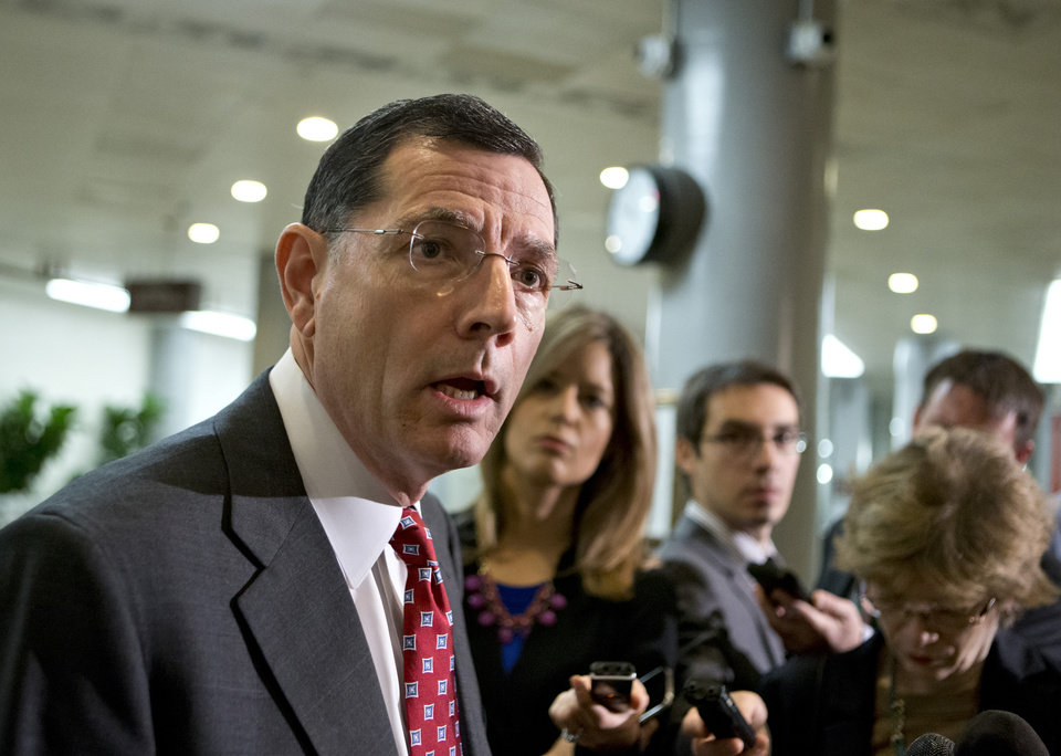 Sen. John Barrasso, R-Wyo., a member of the Senate Foreign Relations Committee, speaks to reporters following a closed-door briefing on the investigation of the deadly Sept. 11 attack on the U.S. consulate in Benghazi, Libya, at the Capitol in Washington, Wednesday, Dec. 19, 2012. An Accountability Review Board's report indicates serious bureaucratic mismanagement was responsible for the inadequate security at the mission in Benghazi where the U.S. ambassador and three other Americans were killed. (AP Photo/J. Scott Applewhite)