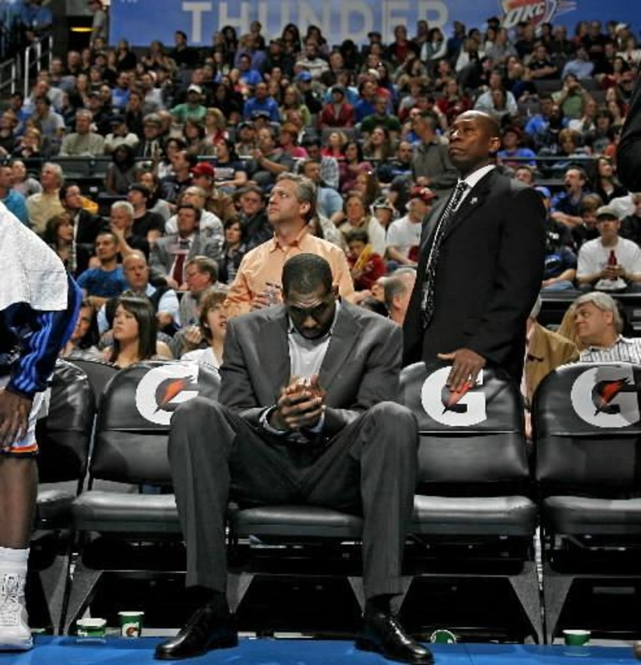Oklahoma City's  D.J.  White sits on the bench during the NBA basketball game between the Oklahoma City Thunder and the Washington Wizards at the Ford Center in Oklahoma City, Wed., March 4, 2009. PHOTO BY BRYAN TERRY