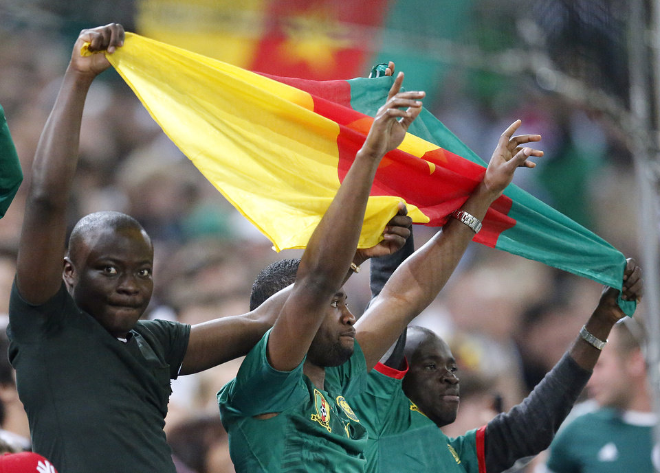 Photo - Cameroon supporters celebrate the 2-2 draw after a friendly WCup preparation soccer match between Germany and Cameroon in Moenchengladbach, Germany, Sunday, June 1, 2014. (AP Photo/Frank Augstein)
