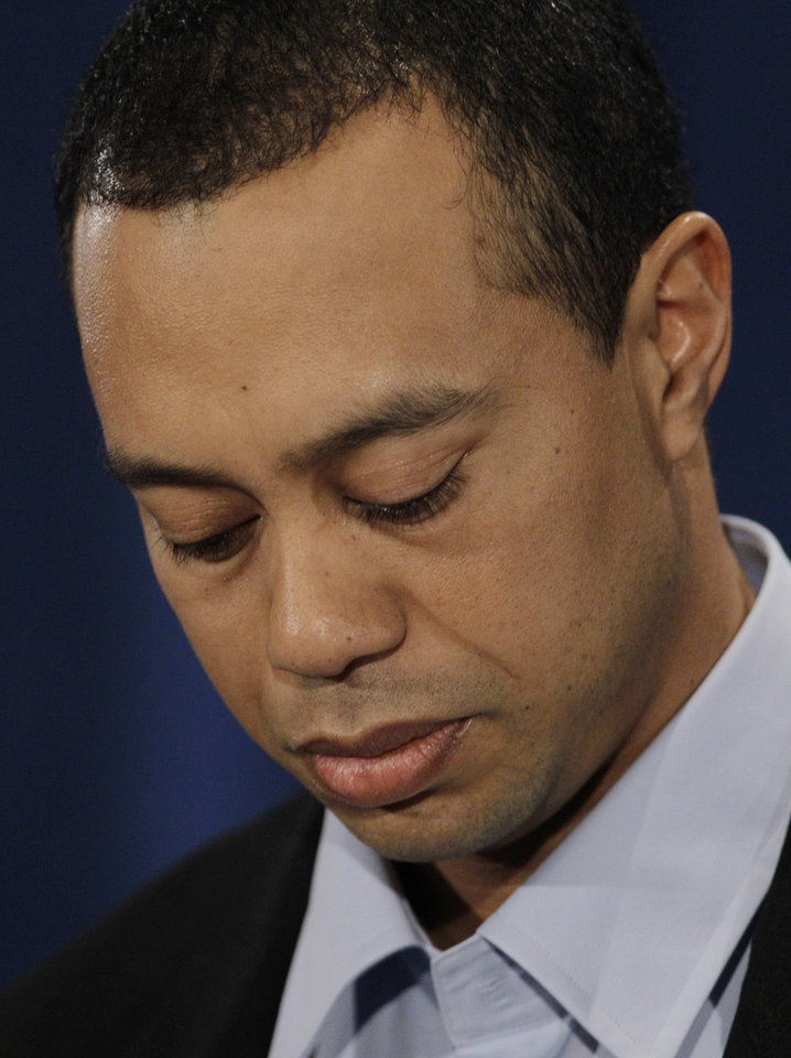 Photo - Tiger Woods pauses during a news conference Friday, Feb. 19, 2010, in Ponte Vedra Beach, Fla. (AP Photo/Eric Gay) ORG XMIT: FLEG109