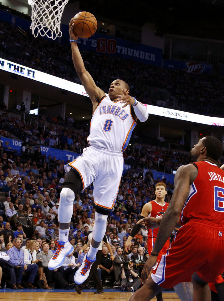 Oklahoma City\'s Russell Westbrook (0) goes to the basket in front of the Clippers Blake Griffin (32) and DeAndre Jordan (6) during an NBA basketball game between the Oklahoma City Thunder and the Los Angeles Clippers at Chesapeake Energy Arena in Oklahoma City, Wednesday, Nov. 21, 2012. Photo by Bryan Terry, The Oklahoman