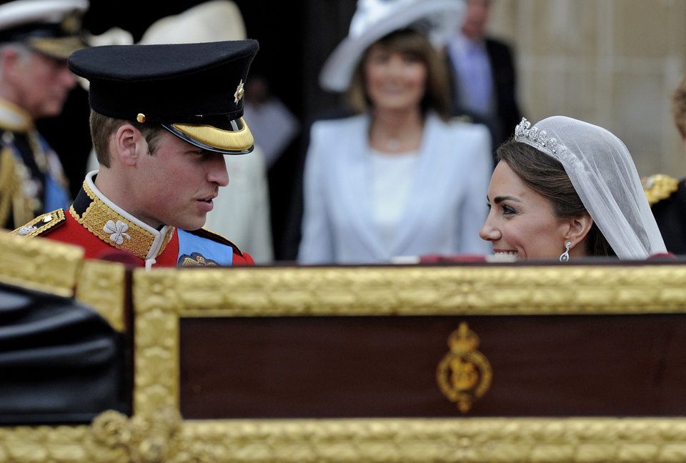 Photo - Britain's Prince William and his wife Kate, Duchess of Cambridge wait to get into a landau outside of Westminster Abbey after their Royal Wedding in London Friday, April, 29, 2011. (AP Photo/Martin Meissner) ORG XMIT: RWMG154