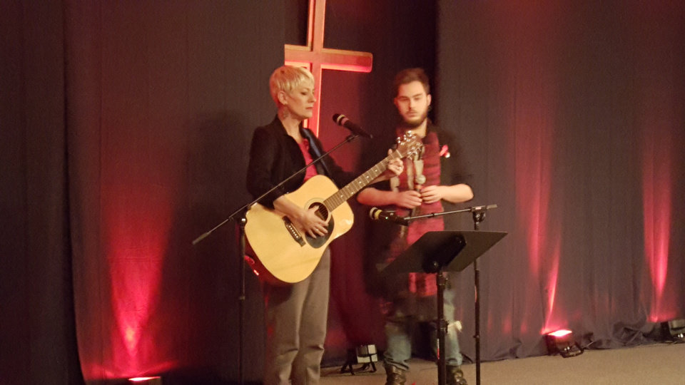 Photo - Sara and Parker Cunningham perform a song at the 2015 World AIDS Day Service on Tuesday, Dec. 1 at Expressions Church in Oklahoma City.