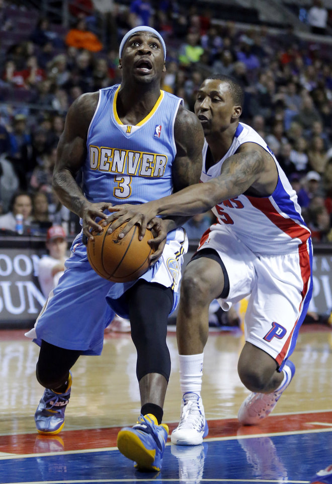 Photo - Detroit Pistons guard Kentavious Caldwell-Pope (5) knocks the ball away from Denver Nuggets guard Ty Lawson (3) during the first half of an NBA basketball game on Saturday, Feb. 8, 2014, in Auburn Hills, Mich. (AP Photo/Duane Burleson)
