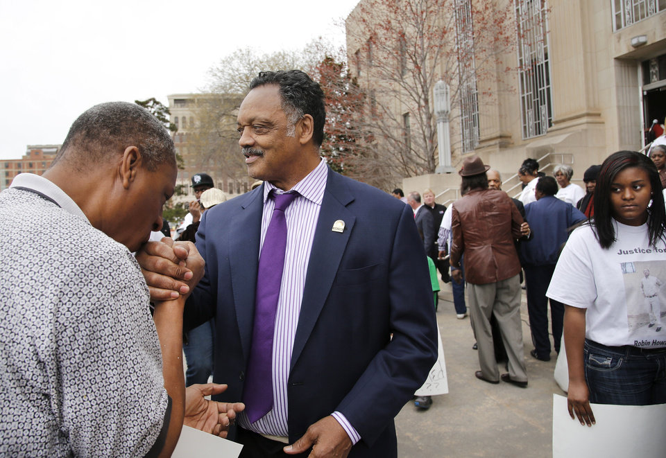 Photo - After the rally, this man clasped Rev. Jackson's hand, shook it and then kissed it as Jackson was leaving City Hall. Rev. Jesse Jackson joined local pastors and clivil rights leaders in a march in downtown Oklahoma City to voice their concern about what they say is a lack of information released by Police Chief Bill Citty regarding the  death of a man who died while in police custody in June, 2012.  Family members of  Howard were among the more than 100 people who peacefully marched Tuesday afternoon, March 19, 2013,  from Oklahoma City police headquarters to the east side of City Hall where Jackson assured the marchers he would not relent keeping pressure on the police department and its chief to find answers about Howard's death.    Photo by Jim Beckel, The Oklahoman