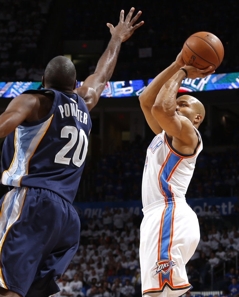 Oklahoma City\'s Dereck Fisher soots over Memphis\' Quincy Pondexter during Game 2 in the second round of the NBA playoffs between the Oklahoma City Thunder and the Memphis Grizzlies at Chesapeake Energy Arena In Oklahoma City, Tuesday, May 7, 2013. Photo by Bryan Terry, The Oklahoman