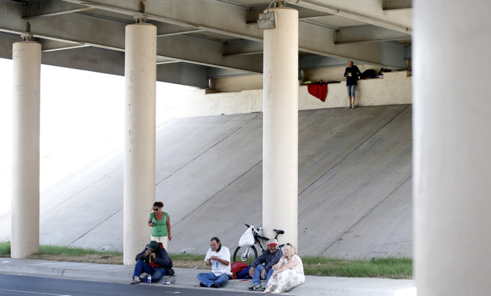 Photo - People watch a Church Under the Bridge service in Oklahoma City.  SARAH PHIPPS