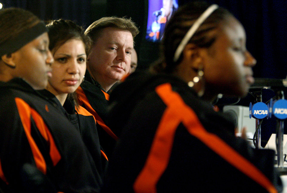 Photo - OSU coach Kurt Budke listens to Andrea Riley, right, answer questions during a press conference the day before the second round game of the women's NCAA basketball tournament  between Oklahoma State University and Florida State University at Wells Fargo Arena, Sunday, March 23, 2008, in Des Moines, Iowa. Oklahoma State University will play Florida State University on Monday, March 24, 2008.   BY BRYAN TERRY, THE OKLAHOMAN