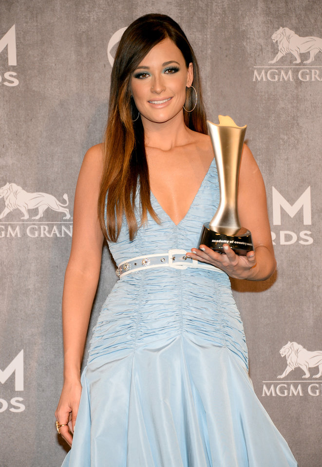 Photo - Kacey Musgraves poses in the press room with the award for album of the year at the 49th annual Academy of Country Music Awards at the MGM Grand Garden Arena on Sunday, April 6, 2014, in Las Vegas. (Photo by Al Powers/Powers Imagery/Invision/AP)