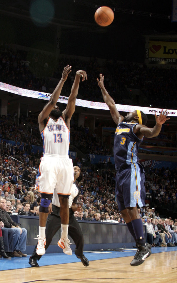 Photo - Oklahoma City's James Harden (13) shoots over Denver's Ty Lawson (3) during the NBA basketball game between the Oklahoma City Thunder and the Denver Nuggets at the Chesapeake Energy Arena, Sunday, Feb. 19, 2012. Photo by Sarah Phipps, The Oklahoman