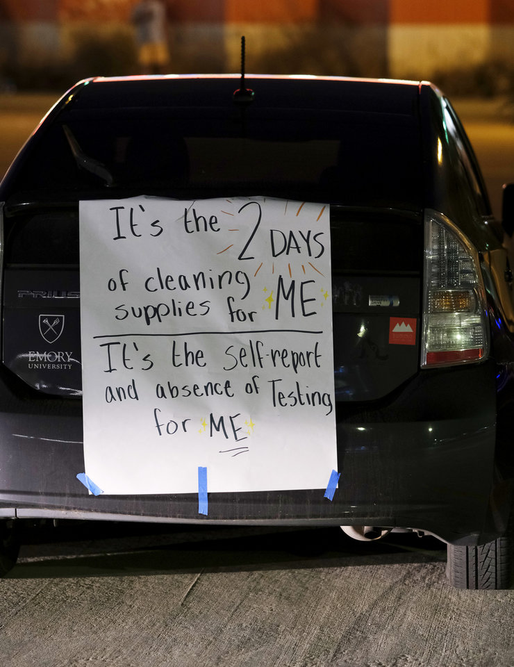 Photo - Sign on the back of a car in the parking lot at the first live Oklahoma City School Board meeting in the new Clara Luper Center for Educational Services, Monday, November 9, 2020. [Doug Hoke/The Oklahoman]