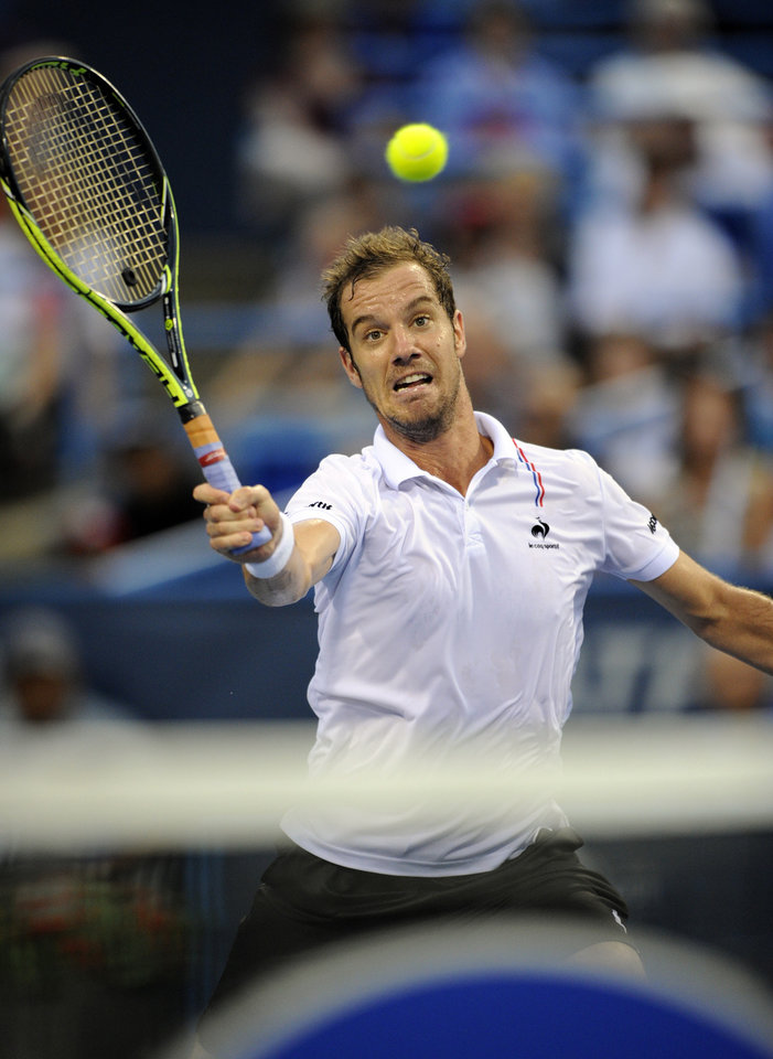 Photo - Richard Gasquet, of France, reaches for the ball against Vasek Pospisil, of Canada, during a match at the Citi Open tennis tournament, Saturday, Aug. 2, 2014, in Washington. (AP Photo/Nick Wass)