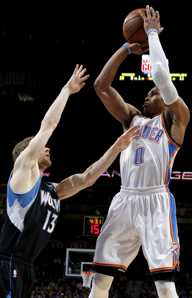Photo - Oklahoma City's Russell Westbrook (0) takes a shot over Minnesota's Luke Ridnour (13) during an NBA basketball game between the Oklahoma City Thunder and the Minnesota Timberwolves at Chesapeake Energy Arena in Oklahoma City, Wednesday, Jan. 9, 2013.  Photo by Bryan Terry, The Oklahoman