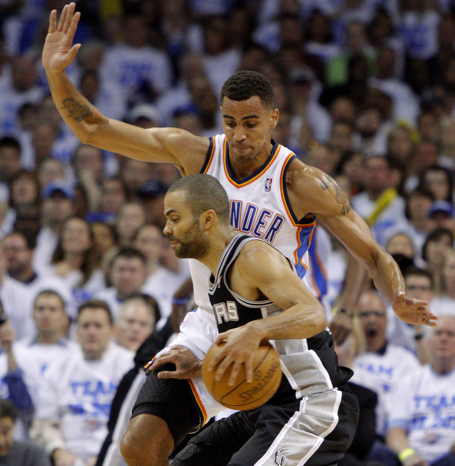 Oklahoma City's Thabo Sefolosha (2) defends San Antonio's Tony Parker (9) during Game 4 of the Western Conference Finals between the Oklahoma City Thunder and the San Antonio Spurs in the NBA playoffs at the Chesapeake Energy Arena in Oklahoma City, Saturday, June 2, 2012. Photo by Bryan Terry, The Oklahoman