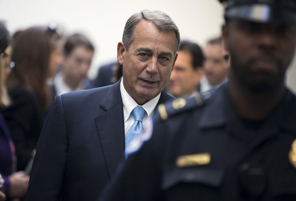 Photo - Speaker of the House Rep. John Boehner, R-Ohio, arrives for a news conference after a House GOP meeting on Capitol Hill on Tuesday, Oct. 15, 2013 in Washington. House GOP leaders Tuesday floated a plan to fellow Republicans to counter an emerging Senate deal to reopen the government and forestall an economy-rattling default on U.S. obligations. But the plan got mixed reviews from the rank and file and it was not clear whether it could pass the chamber.  (AP Photo/ Evan Vucci)