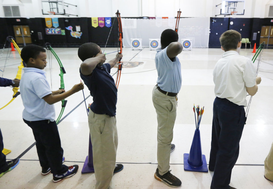 Students take aim during archery class at Martin Luther King Jr. Elementary School in Oklahoma City, Tuesday January 29, 2014. Photo By Steve Gooch, The Oklahoman