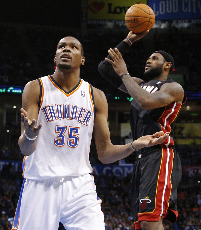 Oklahoma City's Kevin Durant (35) reacts to a foul on the Thunder beside Miami's LeBron James (6) an NBA basketball game between the Oklahoma City Thunder and the Miami Heat at Chesapeake Energy Arena in Oklahoma City, Thursday, Feb. 20, 2014. Oklahoma CIty lost 103-81. Photo by Bryan Terry, The Oklahoman