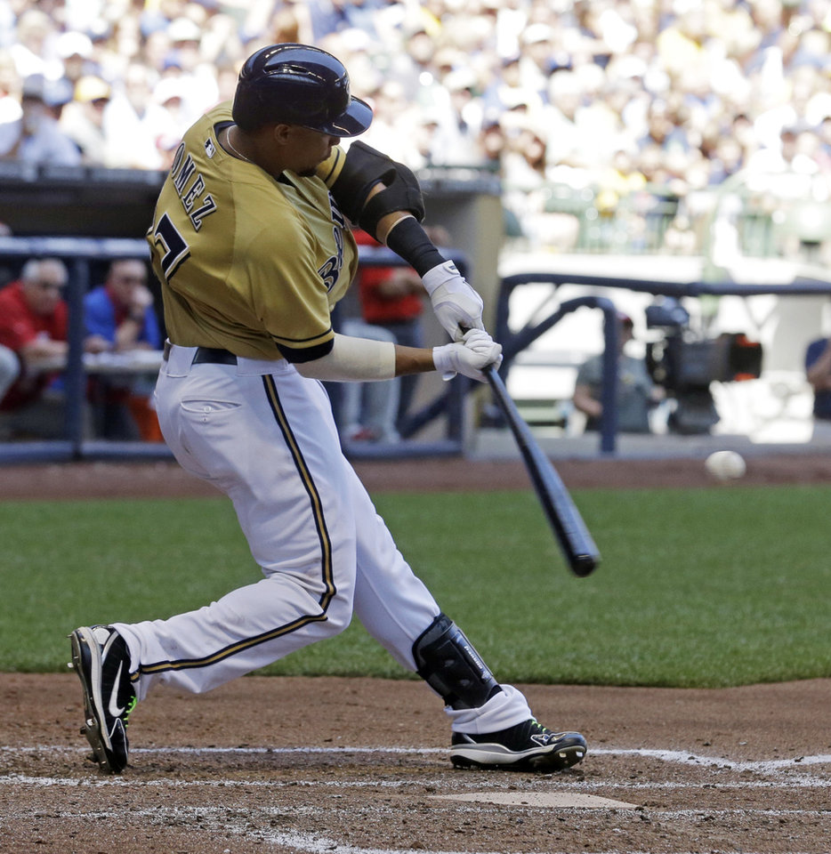 Photo - Milwaukee Brewers' Carlos Gomez hits a home run during the sixth inning of a baseball game against the Philadelphia Phillies Thursday, July 10, 2014, in Milwaukee. (AP Photo/Morry Gash)