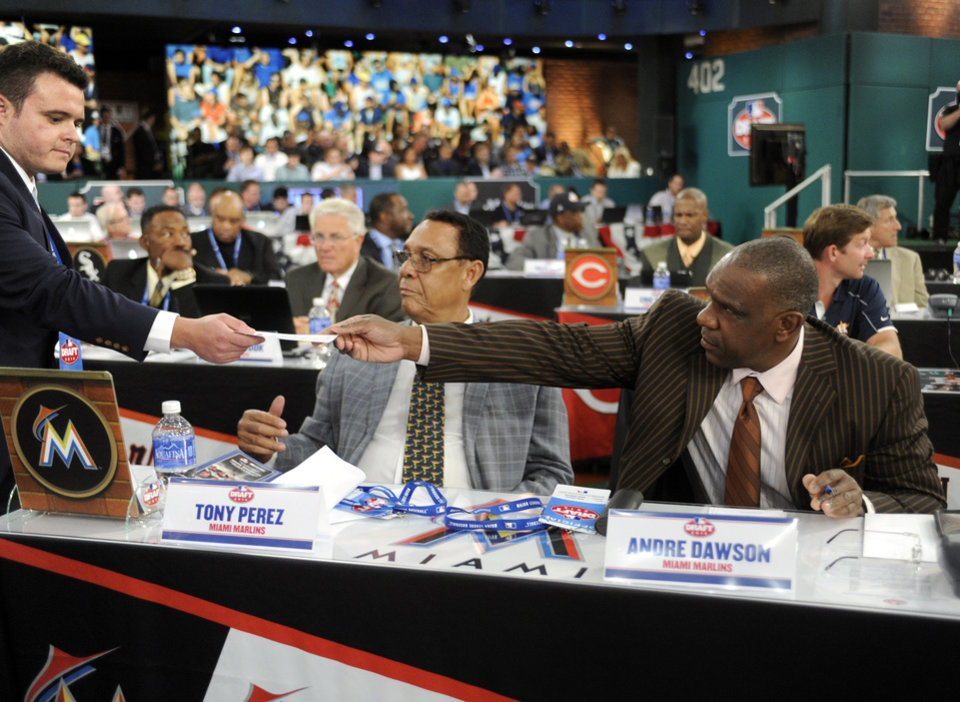 Photo - Miami Marlins representatives Tony Perez, left, and Andre Dawson hand over their pick during the 2014 MLB baseball draft Thursday, June 5, 2014, in Secaucus, N.J. The Marlins chose Tyler Kolek with the second pick in the draft. (AP Photo/Bill Kostroun)