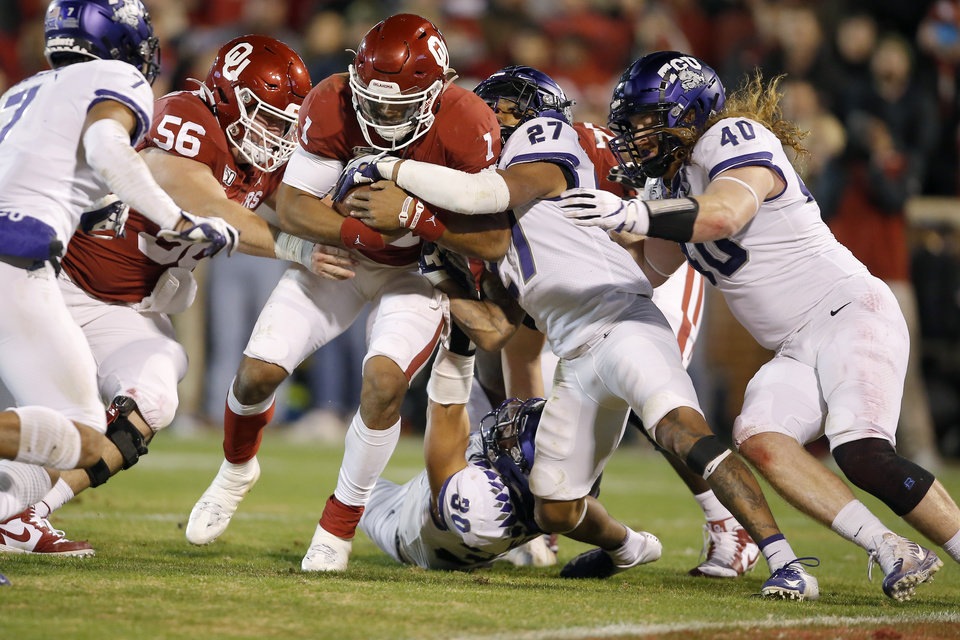 Photo - Oklahoma's Jalen Hurts (1) pushes his way to the end zone in the third quarter of an NCAA football game between the University of Oklahoma Sooners (OU) and the TCU Horned Frogs at Gaylord Family-Oklahoma Memorial Stadium in Norman, Okla., Saturday, Nov. 23, 2019. Oklahoma won 28-24. [Bryan Terry/The Oklahoman]