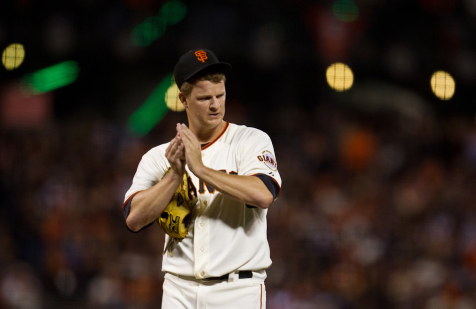 San Francisco Giants' Matt Cain rubs up a new baseball after giving up a two-run home run to Cincinnagi Reds Brandon Phillips during the third inning of Game 1 of a National League baseball division series, Saturday, Oct. 6, 2012, in San Francisco. (AP Photo/The Sacramento Bee, Jose Luis Villegas) MAGS OUT; TV OUT (KCRA3, KXTV10, KOVR13, KUVS19, KMAZ31, KTXL40) MANDATORY CREDIT