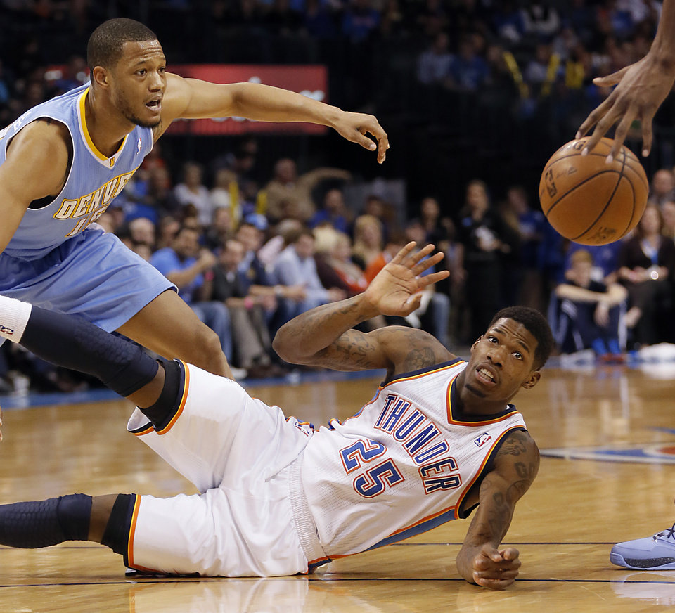 Oklahoma City\'s DeAndre Liggins (25) gets a steal from Denver\'s Anthony Randolph (15) during the NBA basketball game between the Oklahoma City Thunder and the Denver Nuggets at the Chesapeake Energy Arena on Wednesday, Jan. 16, 2013, in Oklahoma City, Okla. Photo by Chris Landsberger, The Oklahoman