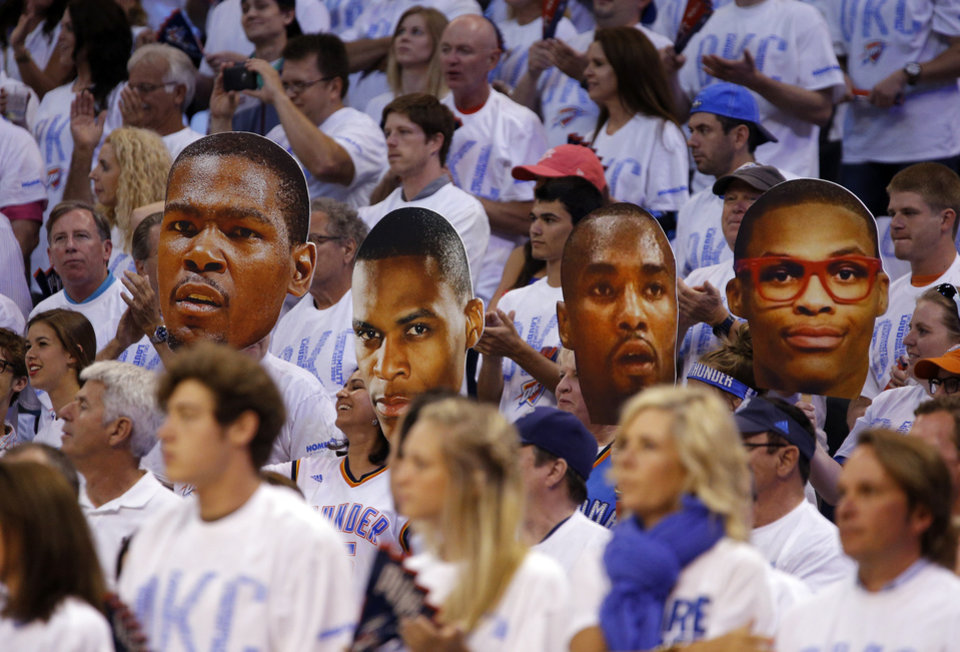 Photo - Fans hold Thunder player cutouts during Game 6 of the Western Conference Finals in the NBA playoffs between the Oklahoma City Thunder and the San Antonio Spurs at Chesapeake Energy Arena in Oklahoma City, Saturday, May 31, 2014. Photo by Bryan Terry, The Oklahoman