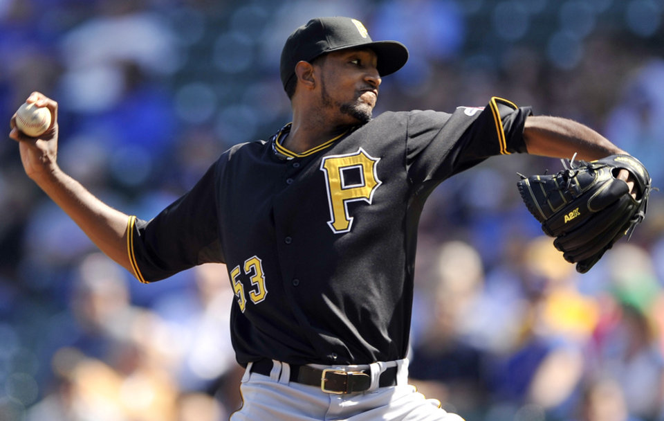 Photo -   Pittsburgh Pirates starter James McDonald delivers a pitch against the Chicago Cubs during the first inning of a baseball game in Chicago, Friday, Sept. 14, 2012. (AP Photo/Paul Beaty)