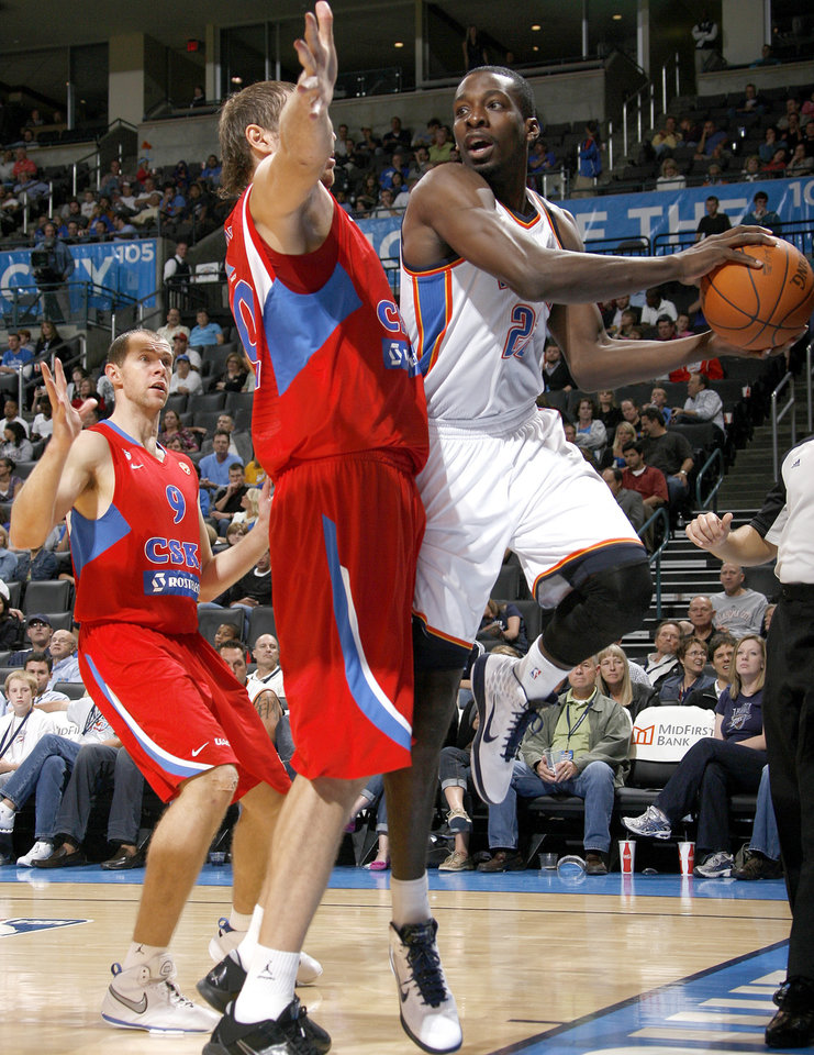 Photo - Oklahoma City's Jeff Green (22) looks to pass around CSKA Moscow's Dmitry Sokolov (30) and Ramunas Siskauskas (9) during the preseason NBA basketball game between the Oklahoma City Thunder and CSKA Moscow in Oklahoma City, Thursday, October 14, 2010. Photo by Bryan Terry, The Oklahoman