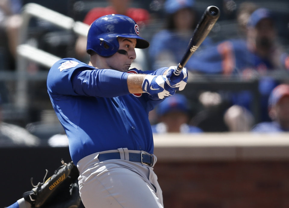 Photo - Chicago Cubs Anthony Rizzo hits an eighth-inning, solo home run off New York Mets relief pitcher Buddy Carlyle in a baseball game at Citi Field in New York, Monday, Aug. 18, 2014. (AP Photo/Kathy Willens)