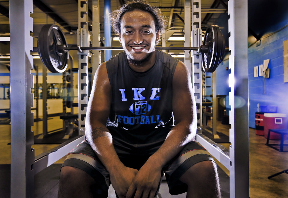 Photo - SUPER 30 / HIGH SCHOOL FOOTBALL PLAYER: Lawton Eisenhower High School's Michael Moana poses for a photo in the weight room at the school on Tuesday, June 18, 2013 in Lawton, Okla.   Photo by Chris Landsberger, The Oklahoman