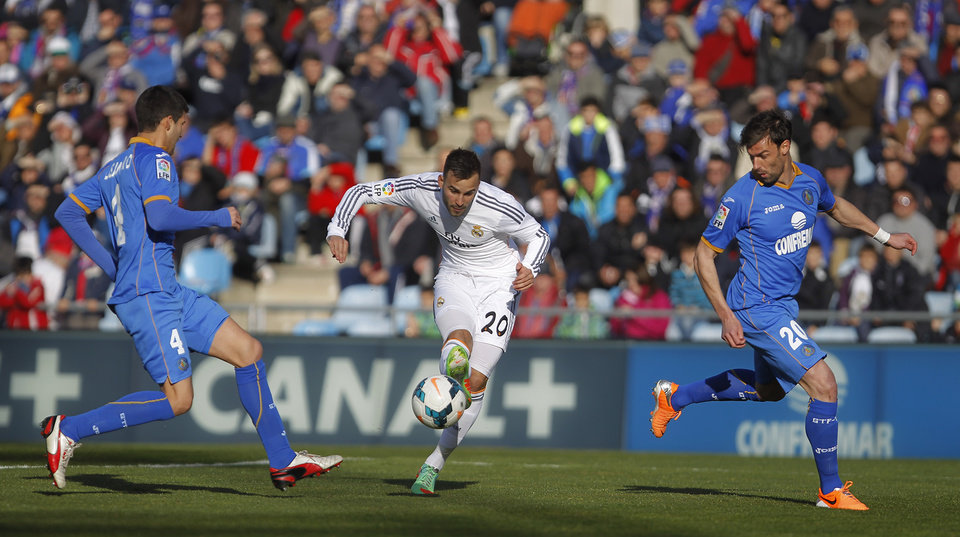 Photo - Real's Jese Rodriguez scores his goal during a Spanish La Liga soccer match between Real Madrid and Getafe at the Coliseum Alfonso Perez stadium in Madrid, Spain, Sunday, Feb. 16, 2014. (AP Photo/Gabriel Pecot)