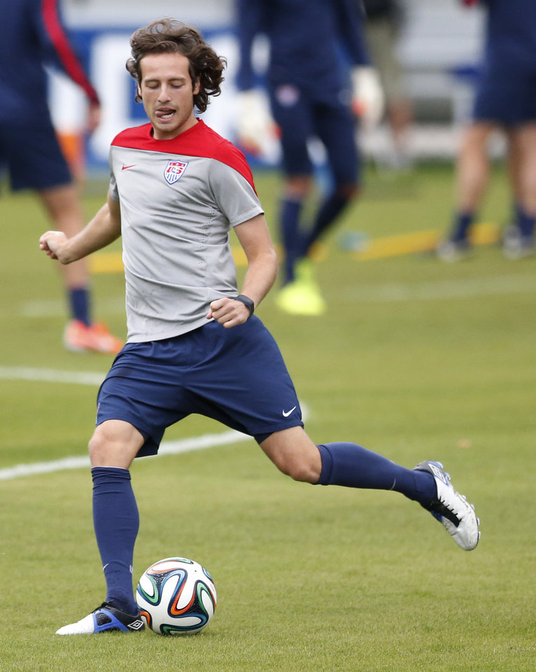 Photo - United States' Mix Diskerud kicks a ball during a training session in Sao Paulo, Brazil, Thursday, June 19, 2014.  The United States will play against Portugal in group G of the 2014 soccer World Cup on June 22. (AP Photo/Julio Cortez)
