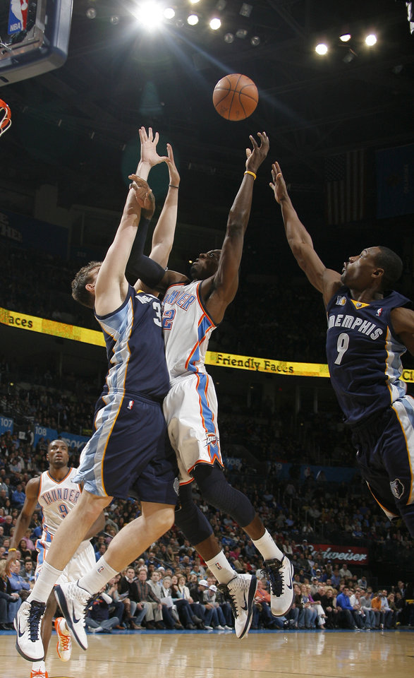 Oklahoma City�s Jeff Green (22) goes to the basket as Memphis' Marc Gasol (33) and Tony Allen (9) defend during the NBA basketball game between the Oklahoma City Thunder and the Memphis Grizzlies, Saturday, Jan. 8, 2011, at the Oklahoma City Arena. Photo by Sarah Phipps, The Oklahoman