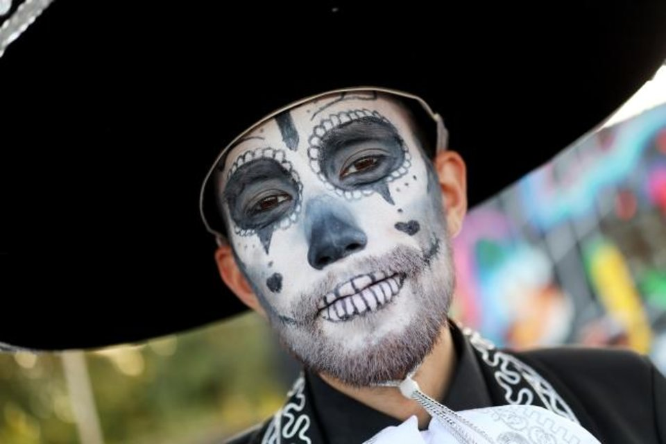 Photo -  Erich Eberle's face is painted for the Day of the Dead celebration in the Plaza District. [DOUG HOKE/THE OKLAHOMAN]