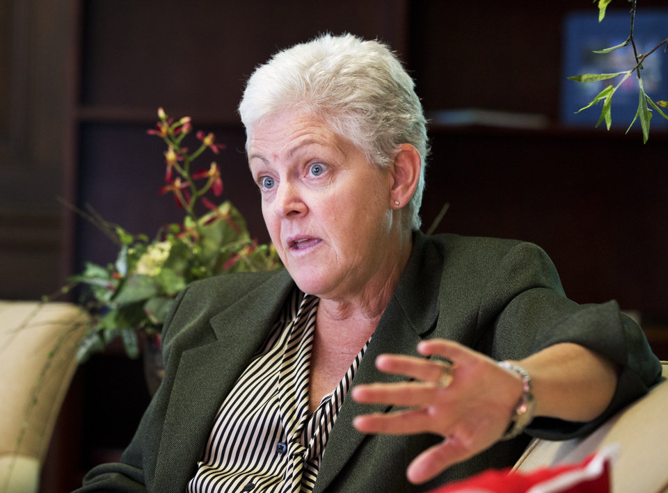 Photo - FILE - In this Aug. 2, 2013, file photo, Environmental Protection Agency Administrator Gina McCarthy speaks to the Associated Press during an interview at her office in Washington. The EPA's inspector general is accusing a unit run by President Barack Obama's political staff inside the EPA of operating as a