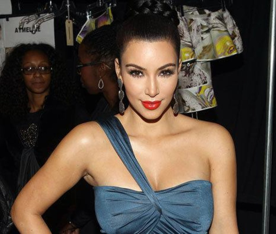 Photo - Kim Kardashian wears a shade of red lipstick with bluish undertones that compliments her olive skin tone. AP Photo.  Donald Traill
