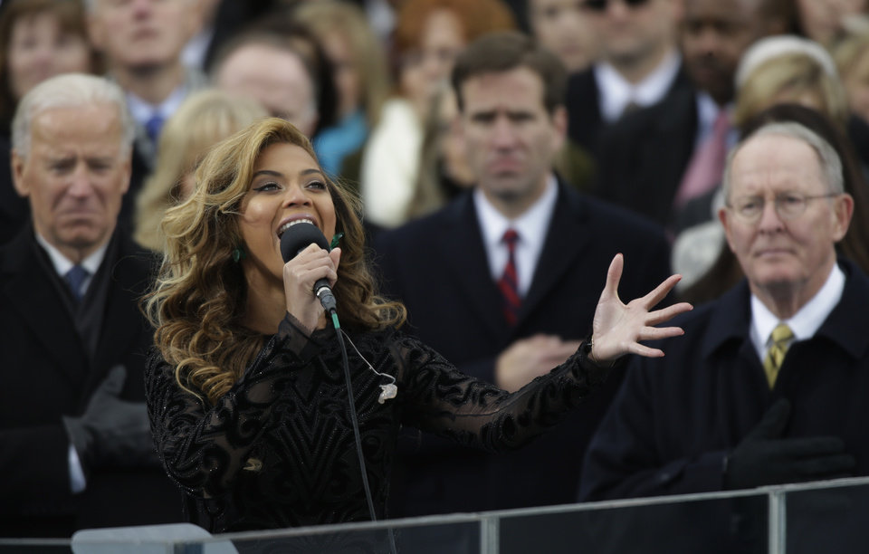 Photo - Beyonce sings the national anthem at the ceremonial swearing-in at the U.S. Capitol during the 57th Presidential Inauguration in Washington, Monday, Jan. 21, 2013. (AP Photo/Pablo Martinez Monsivais)