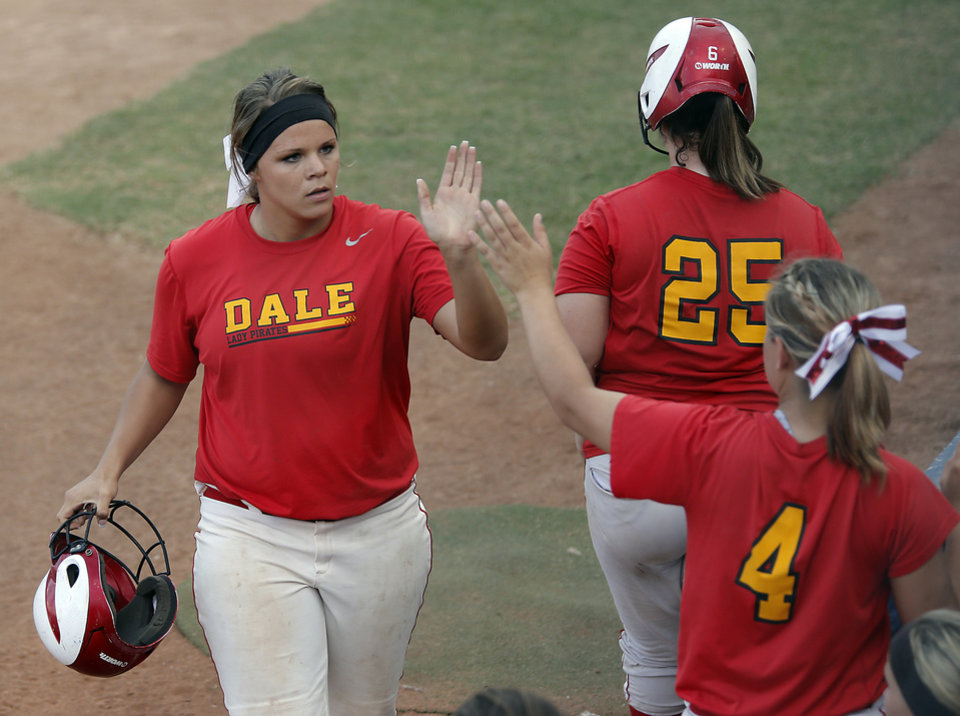 Sam Barry, left, gets a high five from teammate Caitlyn Pitchford (4) after scoring a run against Tushka in the Class 4A Oklahoma State High School Slow Pitch Softball Championship at ASA Hall of Fame Stadium in Oklahoma City, Wednesday, May 1, 2013. Photo by Chris Landsberger, The Oklahoman