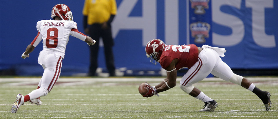 Photo - Alabama's Landon Collins (26) makes an interception on a pass intended for Oklahoma's Jalen Saunders (8) during the NCAA football BCS Sugar Bowl game between the University of Oklahoma Sooners (OU) and the University of Alabama Crimson Tide (UA) at the Superdome in New Orleans, La., Thursday, Jan. 2, 2014.  .Photo by Chris Landsberger, The Oklahoman